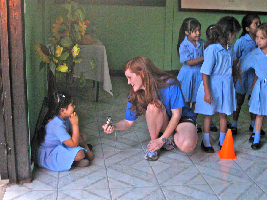 Trip participant playing with school kids